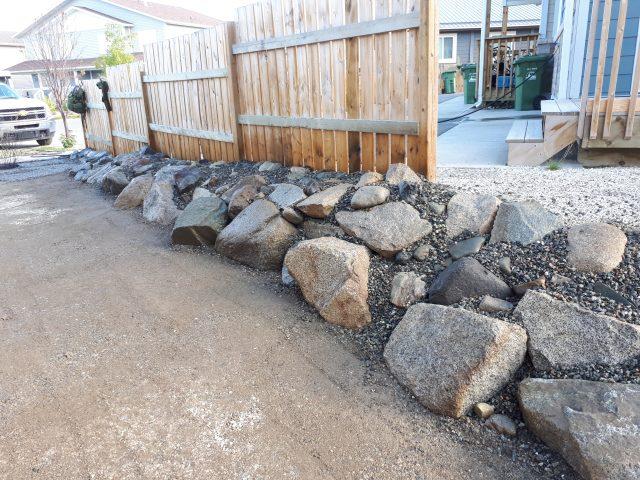 Townhouse Retainment With Shrub Installation