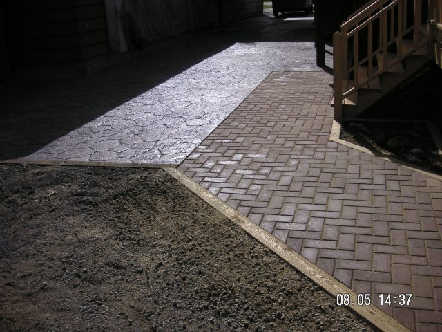 Pavers Used To Compliment Textured Driveway
