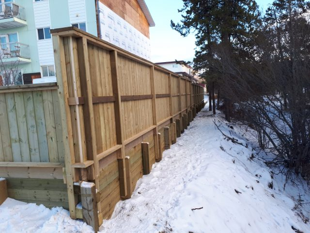 Retaining Wall And Fence Create Solid Barrier