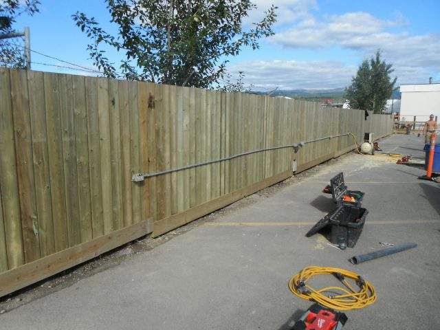 Fence Separates Commercial Properties