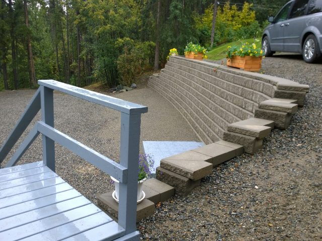 *Updated* Rotting Retaining Wall Replaced And Driveway Secured